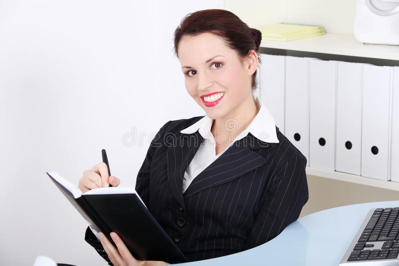 Businesswoman holding open notebook royalty free stock photos