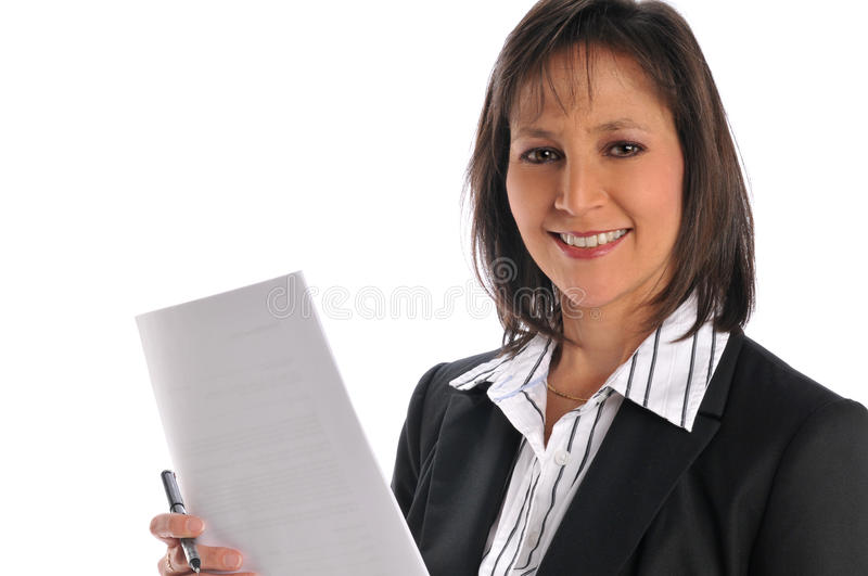 Businesswoman holding a pen and paper