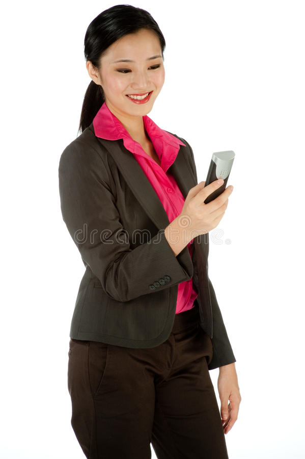 Businesswoman holding a phone royalty free stock photos