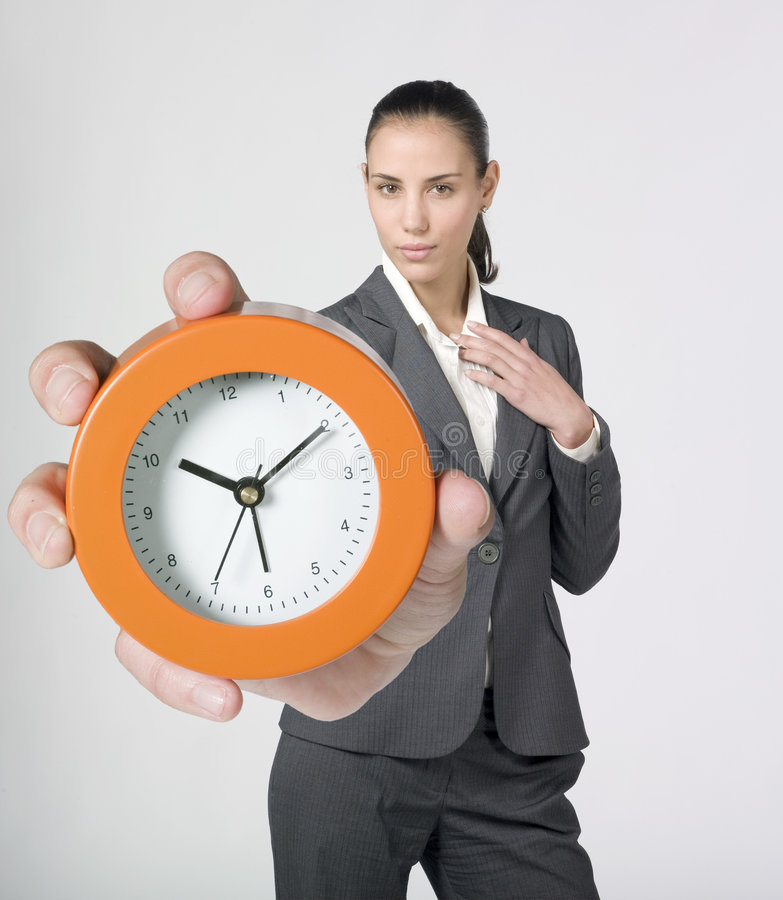Download Businesswoman Holding And Showing Alarm Clock Stock Photo - Image: 7642064