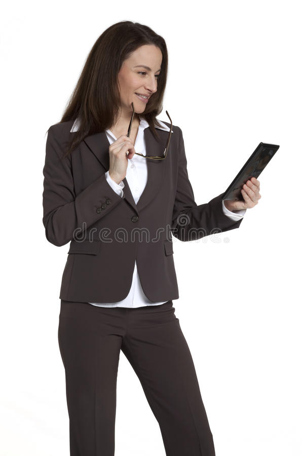 Download Businesswoman Holding Tablet Device Stock Photo - Image: 23051806