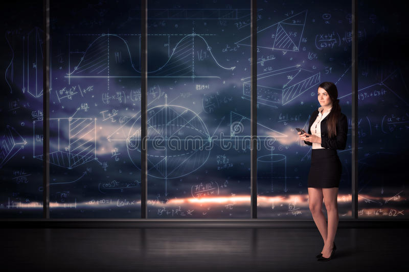 Businesswoman holding tablet in office room with graph charts on stock photos