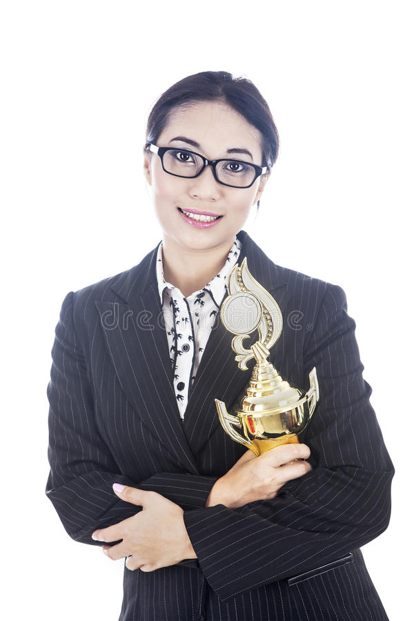 Download Businesswoman Holding Trophy In Her Hands Stock Image - Image: 26969755