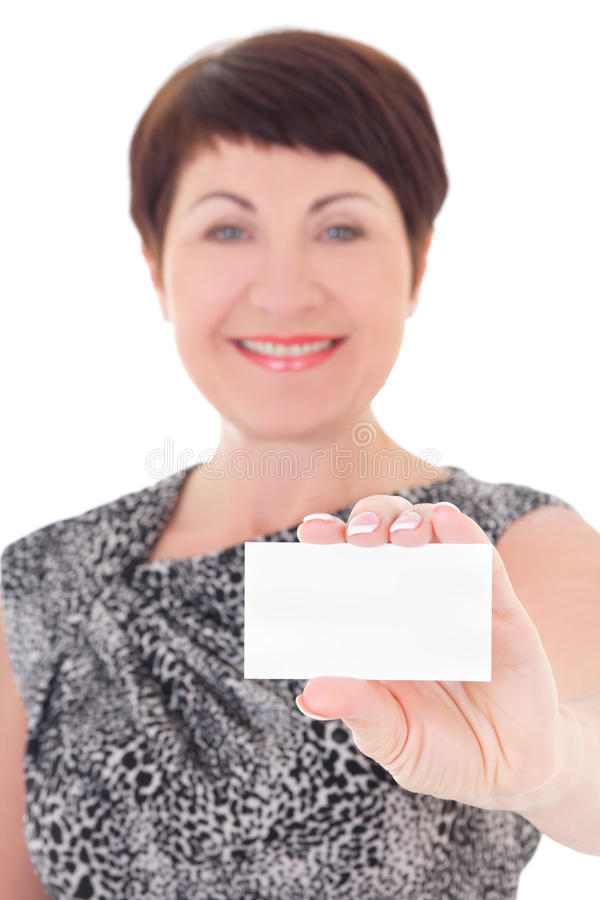 Businesswoman holding visiting card. Beautiful middle aged businesswoman holding visiting card isolated on white background stock photography