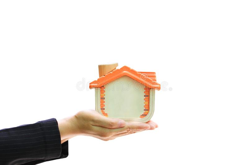 Businesswoman holding wooden house on white background, New home and real estate concept.  stock photography