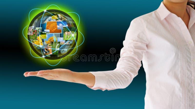 Businesswoman holding world technology. Concept stock photos