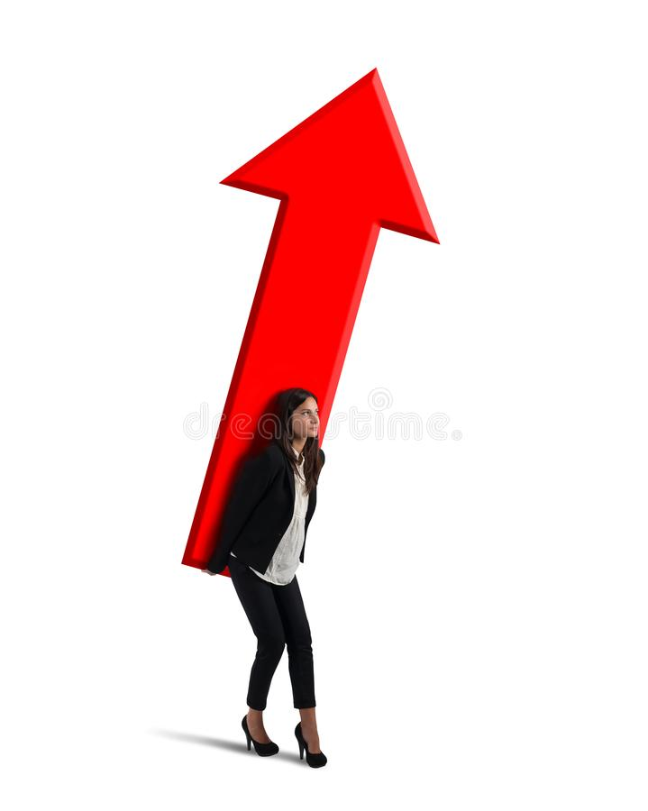 Businesswoman holds a big arrow. Concept of business growth and success royalty free stock images