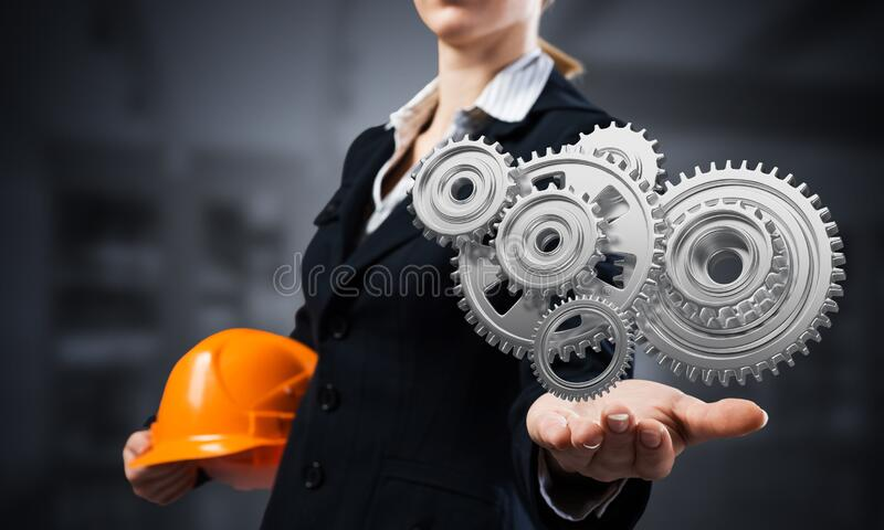 Businesswoman holds in palm gears mechanism royalty free stock photos