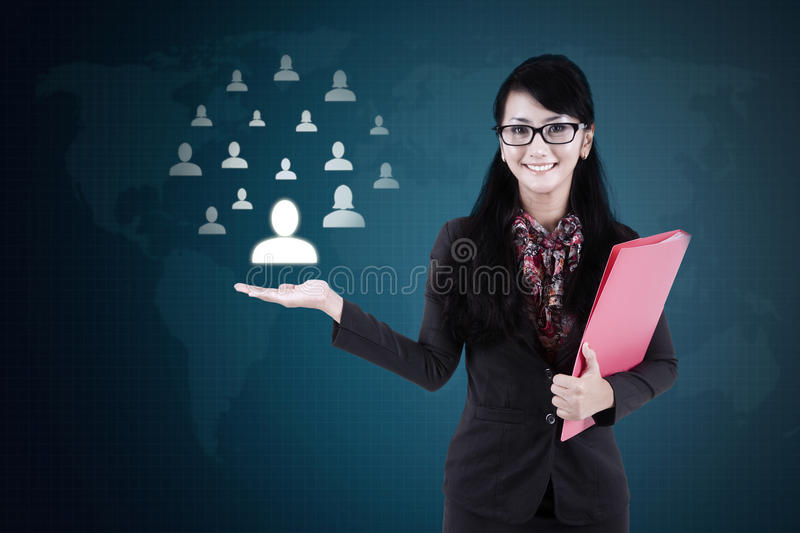 Businesswoman holds social media community icon royalty free stock images
