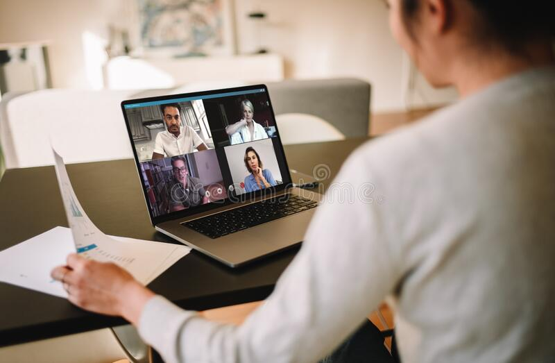 Businesswoman at home having a video conference with her team. Group of business people working from home, having video conference. Businesswoman having a video royalty free stock photo