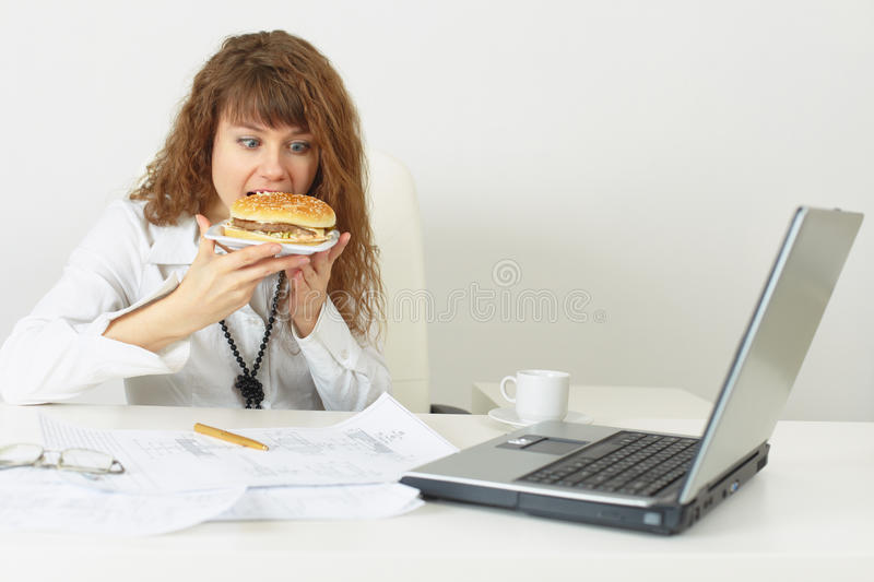 Download Businesswoman Hurries Up To Eat Stock Image - Image: 12233661