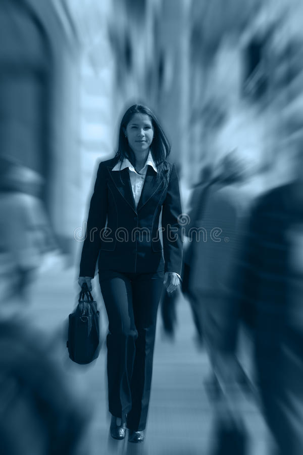 Businesswoman in a hurry stock image