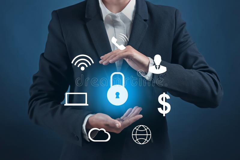 Businesswoman with icons and padlock on dark background. Data security concept royalty free stock images