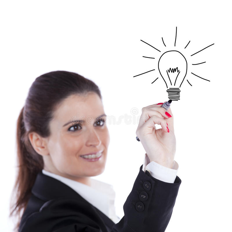Businesswoman ideias. Businesswoman drawing and idea lamp on the whiteboard (selective focus royalty free stock images