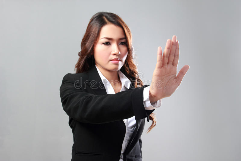 Businesswoman image of hand pushing something to virtual backgro royalty free stock photography