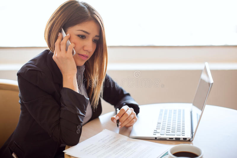 Businesswoman on an important phone call stock photography