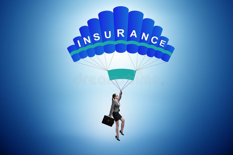 The businesswoman in insurance concept on parachute. Businesswoman in insurance concept on parachute stock photos