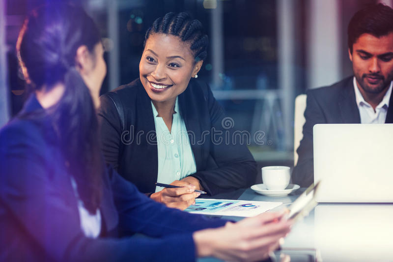 Businesswoman interacting with colleague royalty free stock photography