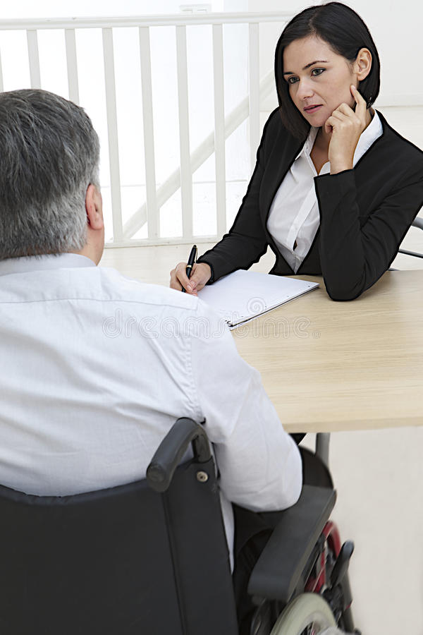 Businesswoman interviewing disabled job royalty free stock photos