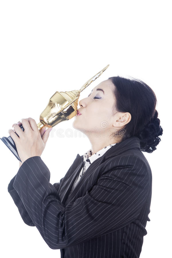 Businesswoman Kissing Trophy Stock Image