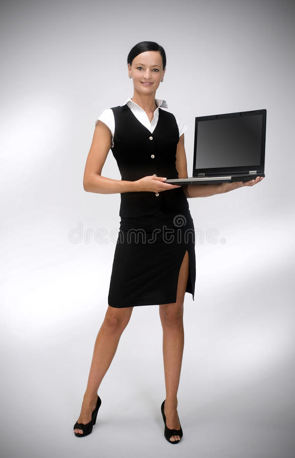 Businesswoman with a laptop royalty free stock photo