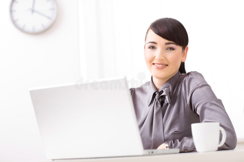 Businesswoman with laptop royalty free stock image