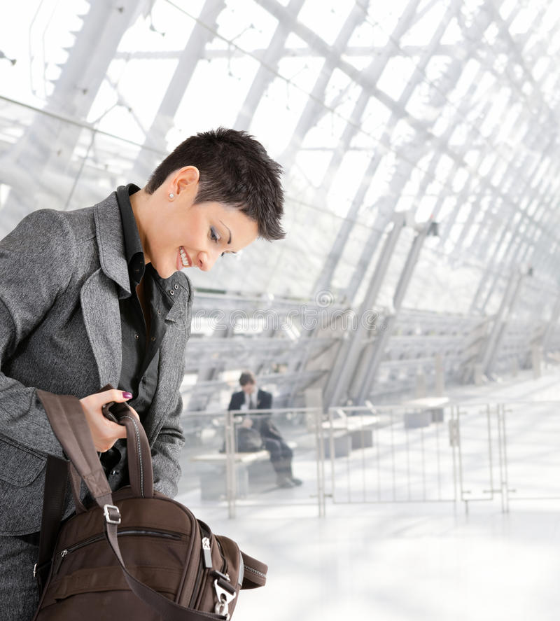 Businesswoman with laptop bag stock photo