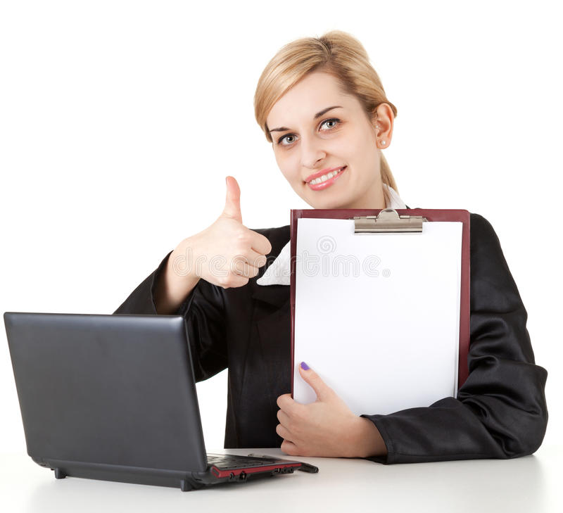 Businesswoman with laptop, clipboard and thumb up