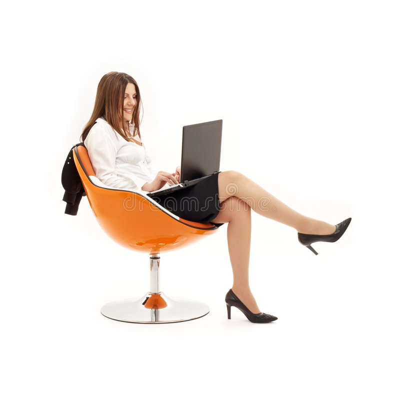 Businesswoman with laptop in o. Range chair over white