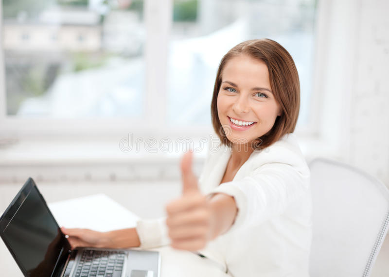 Businesswoman With Laptop In Office Stock Photo