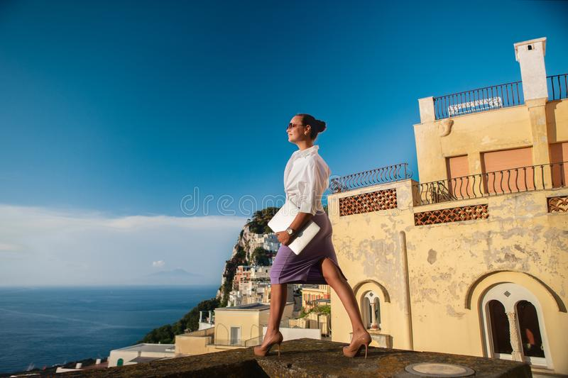 Businesswoman with a laptop on the roof stock photo