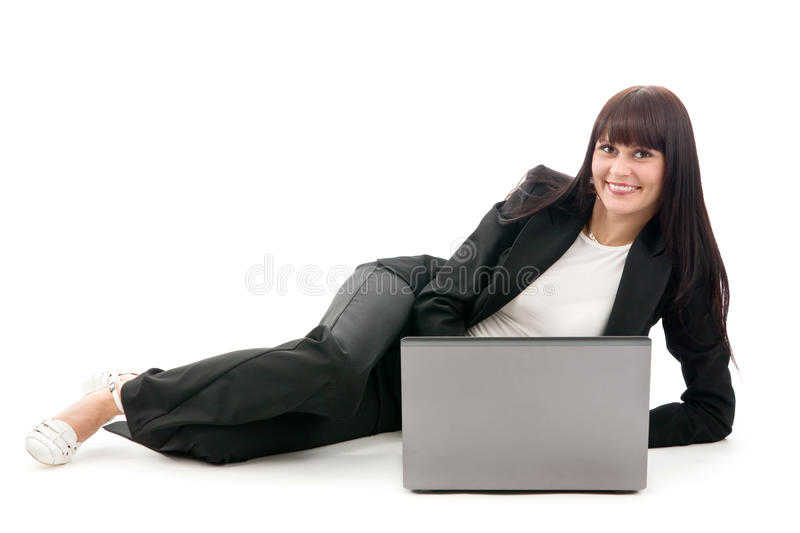 Businesswoman lay with laptop royalty free stock photo
