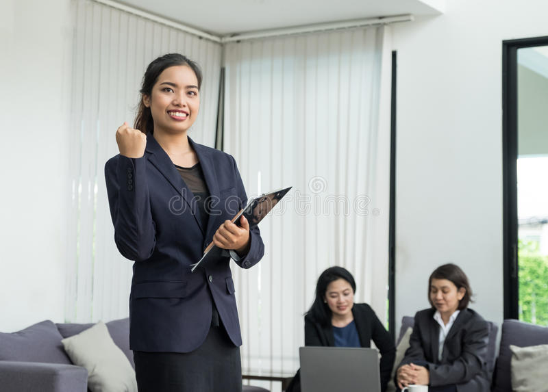 Businesswoman leader arm up for celebrating success with coworkers in office,triumph concept.  stock photography
