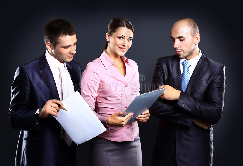 Businesswoman leader on the foreground. Of his team royalty free stock image