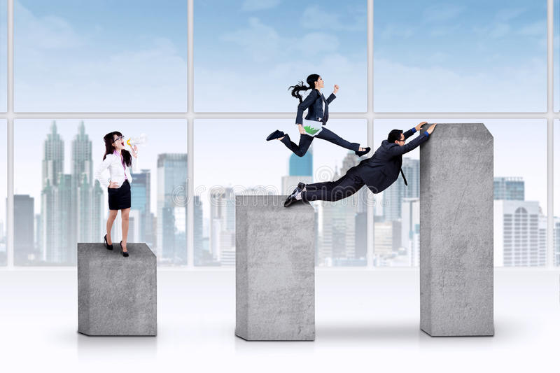 Businesswoman leads her team stock photo