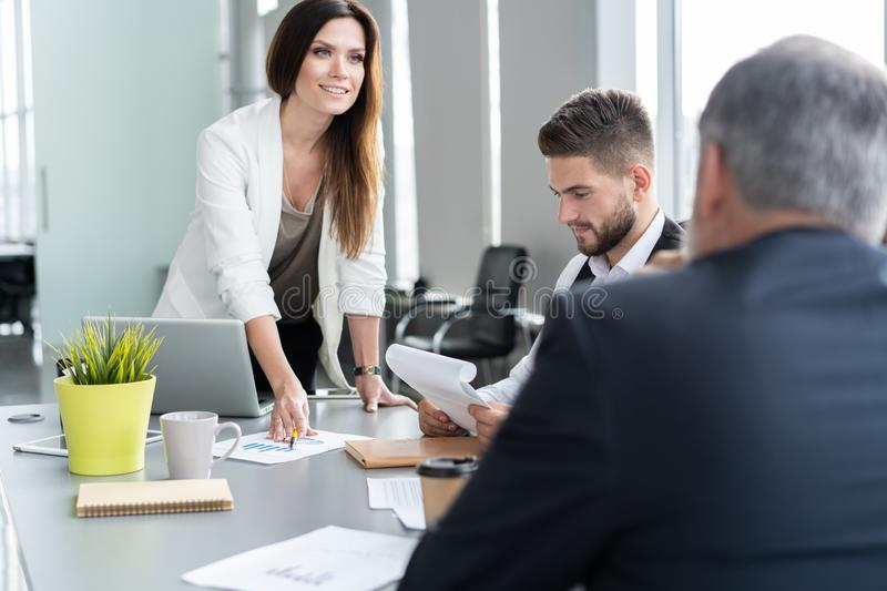 Businesswoman Leads Meeting Around Table. Discussion Talking Sharing Ideas Concept. stock photos