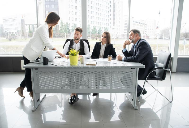 Businesswoman Leads Meeting Around Table. Discussion Talking Sharing Ideas Concept. royalty free stock images