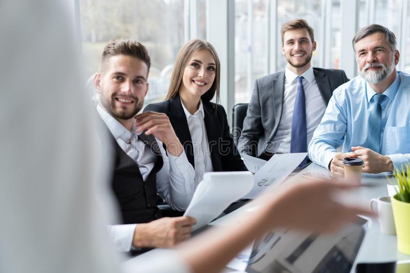 Businesswoman Leads Meeting Around Table. Discussion Talking Sharing Ideas Concept. stock photography