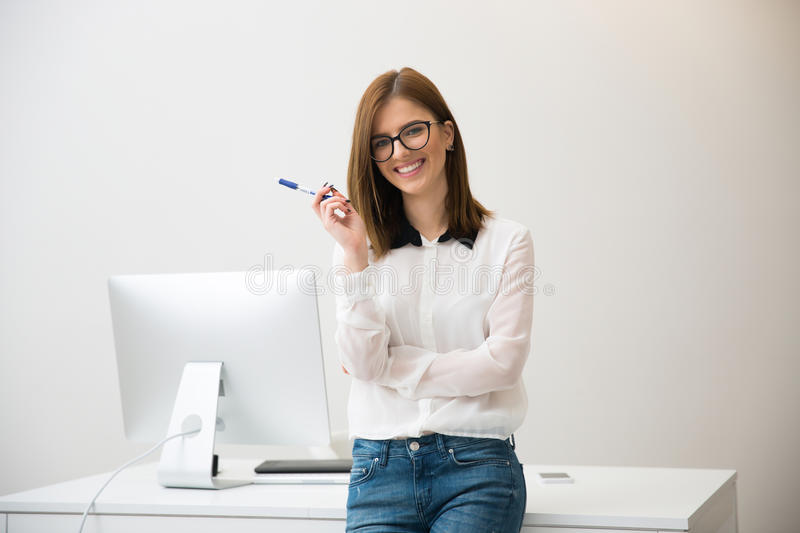 Businesswoman leaning on the table stock image