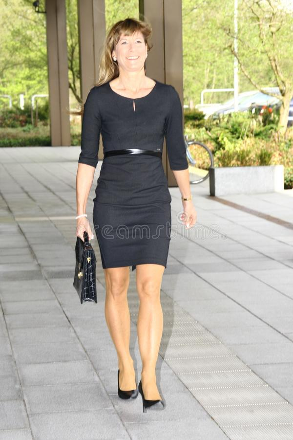Businesswoman leaving a government building royalty free stock photos
