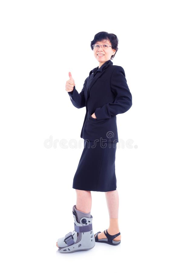 Businesswoman with leg brace standing over white royalty free stock image