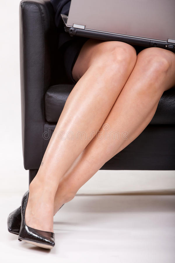 Businesswoman Legs With Laptop Stock Photo - Image of ...