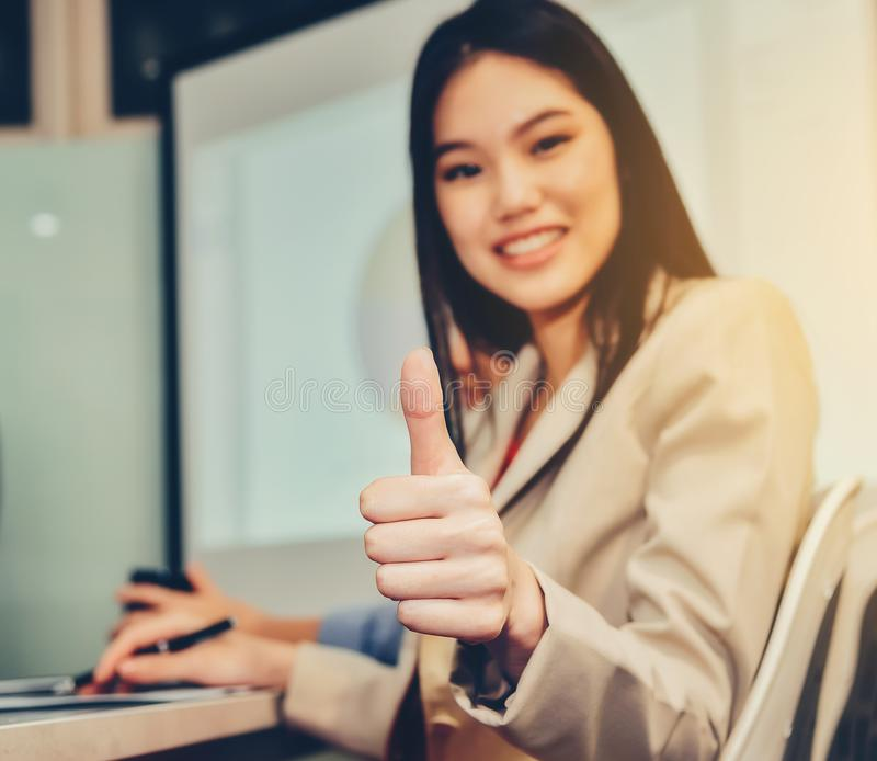 Businesswoman is lifting thumbs To display indescribably and agr stock photos