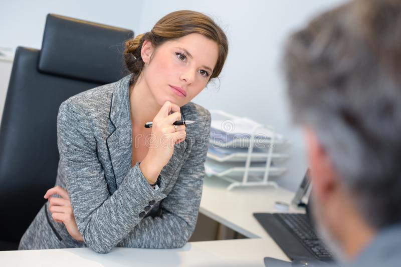 Businesswoman listening attentively to male client stock photos