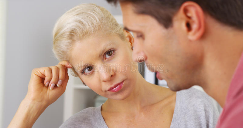 Businesswoman listening to her colleague talk stock image