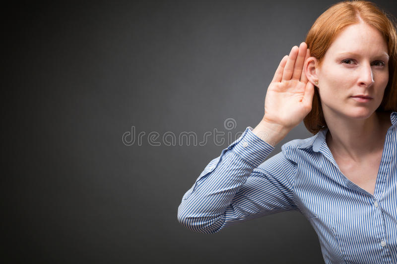 Businesswoman Listens to Something royalty free stock images