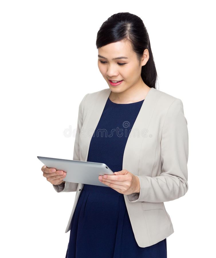 Businesswoman look at digital tablet royalty free stock image