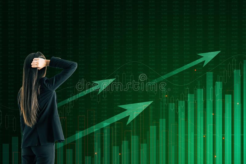Businesswoman looking at business chart royalty free stock images
