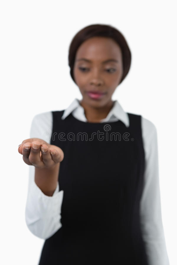 Businesswoman looking on hand. Standing against white background royalty free stock photography
