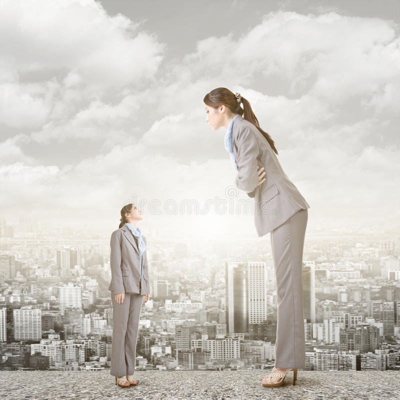 Businesswoman looking on her big version on the roof stock image